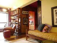 Home of Furniture Designer Tucker Robbins. Vigan bed from the northern Phillippines, covered in Frette silk bedspread. Ikat pillow from Uzbekistan. Photo: Jeff Hirsh. Description: Sian Ballen