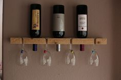 """Wooden wall-mount wine rack made of one solid piece of pine, carefully hand crafted in the USA. - Horizontal wine rack holds 3 bottles of wine and 4 glasses safely. - Size: 24"""" wide, 3 1/2"""" high and 1 1/2"""" deep. Created with a rustic, modern and refined charm. https://www.etsy.com/listing/186222924/wall-wine-rack-handmade-rustic-3-bottle?"""