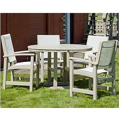 The airy design of this modern POLYWOOD Coastal 5-Piece Outdoor Dining Set…