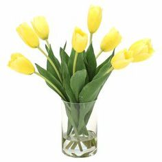 """Bring a touch of natural style to your decor with this lovely faux tulip arrangement, nestled in a classic glass vase. Made in the USA.  Product: Faux floral arrangementConstruction Material: Silk and glassColor: Yellow, green and clearFeatures:  Includes faux tulipsMade in USA Dimensions: 17"""" H x 15"""" W x 14"""" DCleaning and Care: Cleans easily with a duster or dryer on cool setting"""