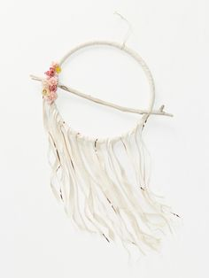 Large Love Dream Catcher | Invite blissful, love-filled dreams into any space with this beautiful large dream catcher designed and made in the USA. With a bohemian look, this decor features natural driftwood, dried flowers and fringe accents of cotton fabric, ribbon and lace.
