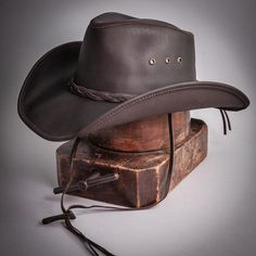 This hat is the perfect pairing of form and function. Built using durable, finished, 100% leather, it's built to last and protect you from the sun and rain on any adventure. Yet with its curved brim, all-leather braided band, and beautiful finish, it's one of our best-looking hats. Choose from a bright, stylish copper leather, or all-black desperado look. #hats #cowboyhats Leather Hats, Braided Leather, Leather Accessories, Fashion Accessories, Braids Band, Hat Hooks, Cowgirl Hats, Hat Stands, Red Carpet Event