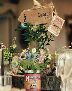 Hiking themed table centres with rustic flowers. Gorgeous Great Outdoors themed wedding in the Lake District. Dottie Photography.