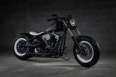 Full custom black and white bobber with Ultima Diamond Gem motor and 240 rear tire.