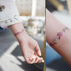 Simple flower wrist tattoo