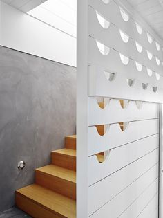 Wood staircase and white walls with half circle designs