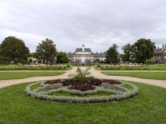"""Parterre gardens (ca.1720) and New Palace/Neues Palais (1819-26 by Christian Friedrich Schuricht).  The gardens of the water-palais of Schloss Pillnitz are a prime example of the anglo-chinois style of the 18th century. Laid out along the Elbe, accessible by barge from Dresden, the initial baroque parterres, featuring three large palais wings with distinct pagoda roofs and chinese decorations, were later enlarged with an """"english"""" garden (1778-80) and a chinese water garden (1790)."""