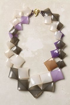 Love the colors and the shape....I think I need this to go with my suit for job interviews.