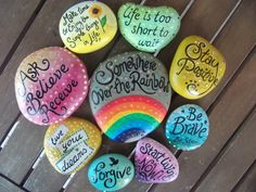 Stones painted with happy, positive, thought provoking messages
