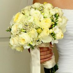 The pale yellow roses add a touch of elegance to this wedding bouquet. Reminds me of my parents wedding colors :)