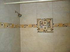 shower tile porcelain, glass, and travertine..my design I made for our shower