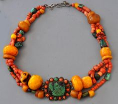 by Linda Pastorino | Restringing of Tibetan necklace using Mongolian clasp. Amber , coral Turquoise. || For sale, contact Linda ~ info@singkiang.com