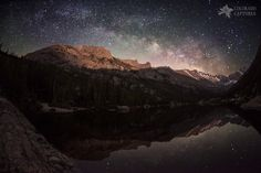 Mills Lake and Longs Peak provide a stunning perspective for this moonlit view of the Milky Way skies above.