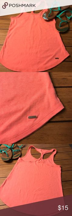 Gorgeous neon pink Hollister racer back tank Perfect summer tank! Neon pink racer back. Pair with a cute skirt or capris. 🌸🌺 bring on the sun! Hollister Tops Tank Tops