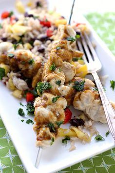 Mango Chicken Skewers with Black Bean and Pineapple Brown Rice. Makes me want to go to the tropics!