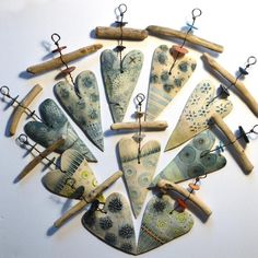 Each unique ceramic heart and driftwood hanger is lovingly handmade by Shirley Vauvelle .