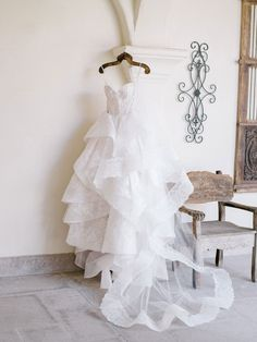real wedding photo at palm springs pond estate wedding dress monique lhuillier tiered skirt wedding dress on hanger at venue Wedding Planner, Destination Wedding, Spring Images, Tiered Skirts, Monique Lhuillier, To My Future Husband, Palm Springs, Real Weddings, Joey Lawrence