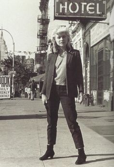 Debbie Harry in New York City. Photo by Bob Gruen.  (in front of CBGB, NYC. May 1977).