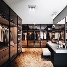 Clean and serene closet inspo ✨ Loving the full height glass doors and modern vanity!