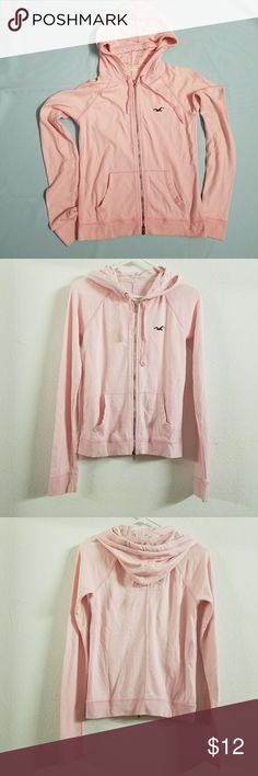 PRICE DROP⬇️ Hollister Pink Zip Hoodie Preloved zip up hoodie.   I use to wear clothes that are loose fitting. I love this hoodie. Pink is my favorite color. I love how casual this hoodie looks. I no longer wear baggy clothes. I've outgrown it.   The hoodie has the Hollister logo printed all over the interior.   It is looking for a new home!  60% cotton 40% polyester  Offers are accepted.  Thank you in advance for your purchase! Hollister Tops Sweatshirts & Hoodies