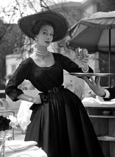 1950s supermodel, Barbara Goalen, modelling a 'New Look' dress.  Photograph by John French