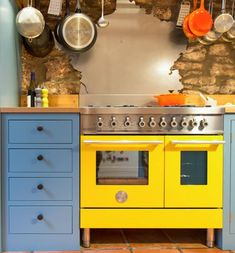 Sustainable Kitchens - A Playful Shaker Kitchen. A Ferrari yellow Bertazzoni range cooker, bespoke France-shaped stainless steel splash back and Stone Blue (Farrow & Ball) oak cabinets give this century cottage a funky updated style. Kitchen Appliance Storage, Kitchen Pantry Cabinets, Kitchen Oven, Shaker Kitchen, Kitchen Appliances, Oak Cabinets, Kitchen Gadgets, Kitchen Colors, Kitchen Design