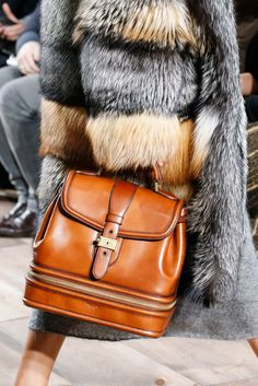 Michael Kors Michael Kors nailed it with this top-handle handbag that reads like a mint-condition treasure you might find at an antique market. It's equal parts luggage and doctor bag with enough hardware to make it special, the right warm caramel leather to make it versatile, and the perfect chubby size to make it practical for everyday. Photo: Gianni Pucci / Indigitalimages.com