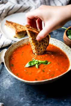 Homemade roasted tomato basil soup with garlic, olive oil and caramelized onions. Delicious, flavorful and the best way to use up garden tomatoes! You'll never want to go back to the canned stuff after you try this.