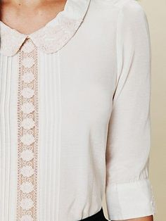 pretty, feminine cream silk crepe blouse with lace inset detail, pin tucking and peter pan collar.  perfect top with a vintage feel