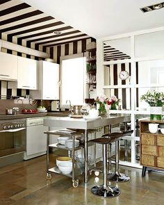 fantastic kitchen with black and white awning striped ceiling and stainless steel