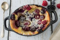 Individual Mixed Berry Clafoutis - -    Clafoutis is a traditional French dessert that falls somewhere between a custard, a souffle, and a pancake. It is silky and light, creamy and dense all at the same time. But the real beauty of clafoutis is how easy it is to whip up. It just requires a few pantry ingredients. My third and final attempt yielded a clafoutis worthy of any pastry chef's dreams.