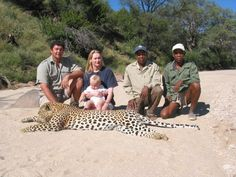 killing leopards for pride and vanity - any fool can kill an animal with a high powered rifle - why do they think they're great? they're obviously weak little scumbags.