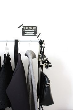 Clothes rail / grey polo-neck in the dressing room of the Scandinavian inspired Bulgarian home of Ivelina at FriChic.