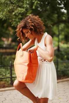 .just a big orange bag and a white dress, right?.