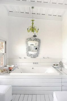 chartreuse chandelier and the biggest bath tub ever, mama wants. i think if i had a window i could see out of next to my tub that i would sit there for hours until the water got cold and i turned into a prune.
