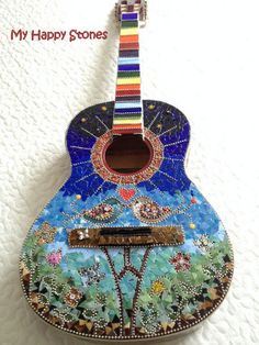 Hey, I found this really awesome Etsy listing at https://www.etsy.com/listing/469889914/mosaic-guitar