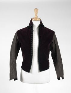 "A shirt worn by Gerard Butler in The Phantom of the Opera (Warner Bros., 2004) in the fictional opera ""Hannibal"" scene within the film. A shirt with brown linen sleeves and burgundy corduroy vest worn under a jacket in the film. Black trim with decorative buttons and hook and eye closure. No labels present."