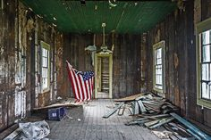 I really have no idea what this American flag is doing in this old, abandoned house.