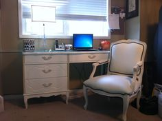 White French provincial desk I refinished with Benjamin Moore Aura paint and a sprayer. White French provincial leather chair with black metal brads.