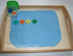 Fish Tumble  Children toss foam fish (numbered 1-9) into the pond (blue felt), and arrange them in numerical order. The foam fish were bought in a package at a craft store. (If these are not available in a package, you can make these by cutting a simple fish shape from craft foam.)