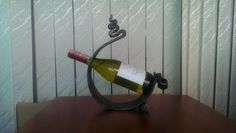 Winehand Metal Handmade Wine Bottle Holder by SteelWoodStoneSWS