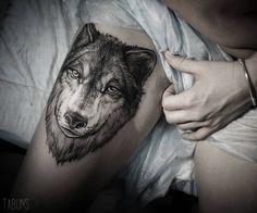wolf tattoo idea on the hip