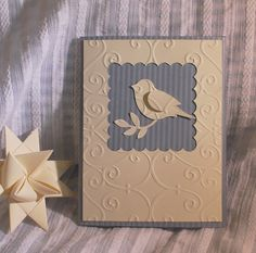 By Wallridge Farm on Etsy. Uses Stampin' Up bird builder punch, negative die-cut, and dry embossing.