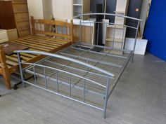 Metal framed double bed (standard 4ft 6) ------------ £35 (pc275)