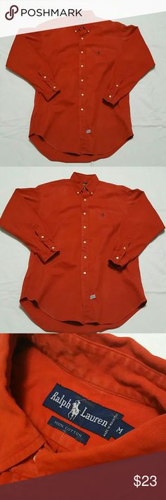 Ralph Lauren Cotton Orange Button Down Shirt -100% Cotton -Ralph Lauren Men Striped Oxford Shirt -Button-down point collar. Applied buttoned placket. -Long sleeves with buttoned barrel cuffs. Blue signature embroidered pony accents the left chest. -Split back yoke with a box pleat ensures a comfortable fit and a greater range of motion. -Machine washable. Imported. Ralph Lauren Shirts Casual Button Down Shirts