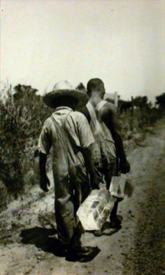 """Eudora Welty took this photograph called """"Carrying the Ice for Sunday Dinner"""" in 1936 near Bolton, Mississippi."""
