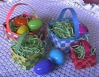 construction paper baskets...i loved making these when i was younger! going to try it again soon!