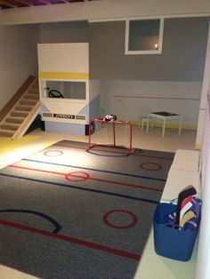 a hockey playroom for a little boy. Treehouse, slide, airbrushed carpet, blackboard paint on wall. Hockey Crafts, Hockey Decor, Boys Hockey Room, Hockey Mom, Hockey Stuff, Man Cave Home Bar, Toy Rooms, Kids Rooms, Reno