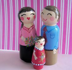 Hand Painted Love Boxes Custom Family of Three Wood Peg Dolls. $130.00, via Etsy.