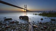 This bridge spans the Tagus River from the Parque das Nações neighbourhood in Lisbon to Montijo, Setúbal district. The view is from Parque Tejo in Lisbon. Wallpapers En Hd, Landscaping Images, Album Photo, Beautiful Sunset, Nature, The Neighbourhood, Places To Visit, Around The Worlds, Bridges
